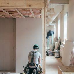 Construction worker working indoors.